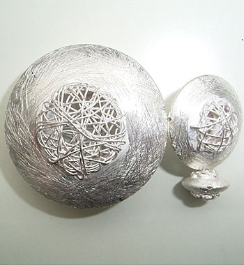 Linse mit Silberdrahtgeflecht